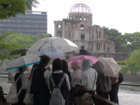 "Japanese school children near Hiroshima Peace Memorial, also known as the Atomic Bomb Dome (""Genbaku Dome""). An exhibition hall, it was the only thing left standing in the area after the bomb. Photo by Catherine Campbell (June 2014)"