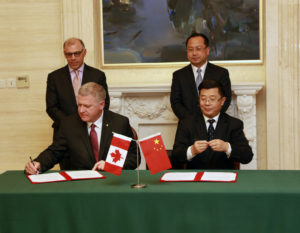 """Look who got the pen? Cecil Clarke signs """"sister city"""" agreement with Chinese city of Dalian"""