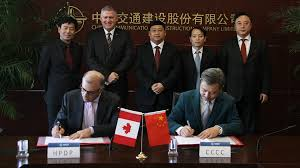Albert Barbusci of HPDP (left) signs a piece of paper with a representative of CCCC.