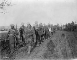 Canadian troops returning from the trenches. November, 1916. Battle of the Somme. (Photo via the Library and Archives of Canada.)