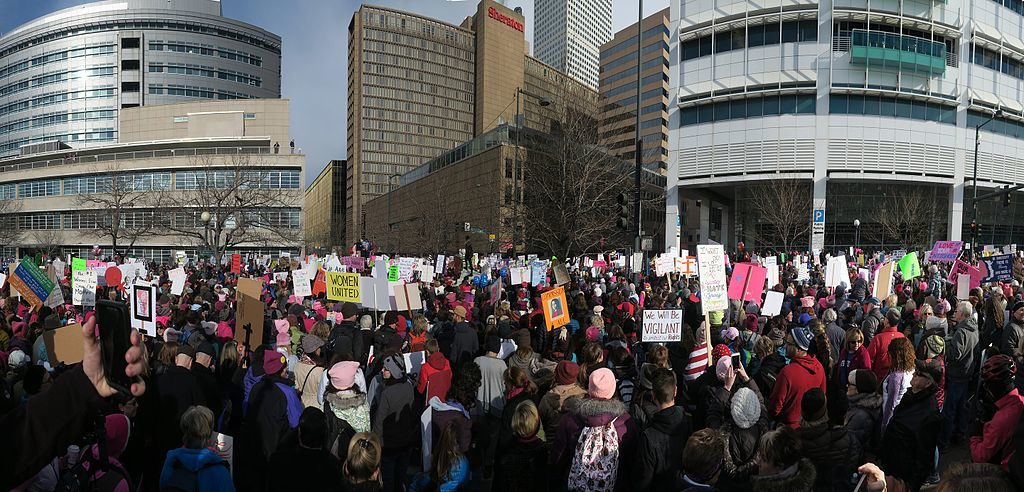 Women's March, Denver, January 2017. (Photo by Ed Ogle, Democracy in Action, CC BY 2.0 http://creativecommons.org/licenses/by/2.0, via Wikimedia Commons)