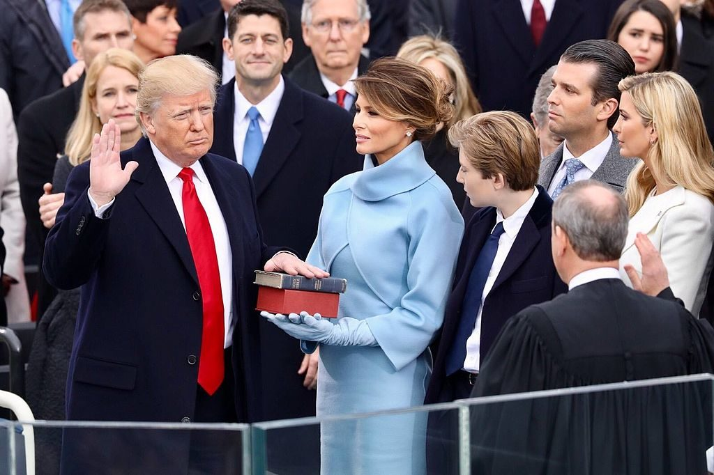 Donald Trump being sworn in as 45th president of the United States. (Photo by White House photographer, Public domain, via Wikimedia Commons)