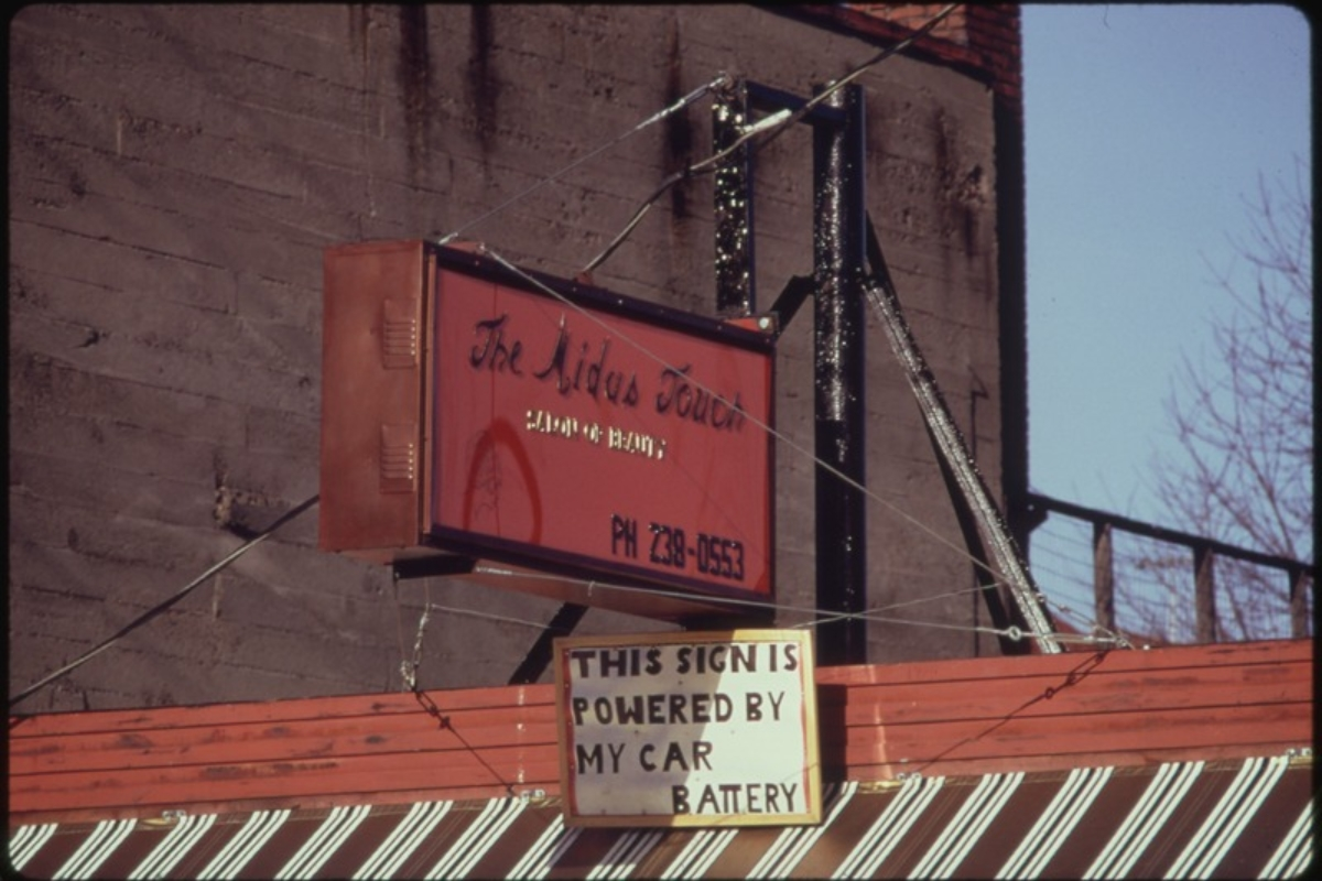 A car battery operated this neon advertising sign over a business, during the energy crisis in December, 1973. US National Archives and Records Administration, via Wikimedia Commons)