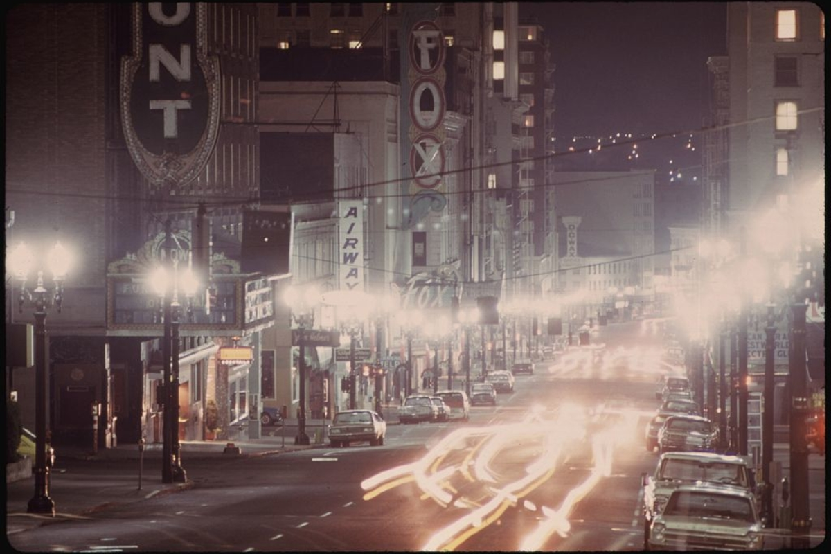 Looking down Southwest Broadway in Portland, during the energy crisis shows limited lighting on a misty evening. (Photo by David Falconer, U.S. National Archives and Records Administration, via Wikimedia Commons)