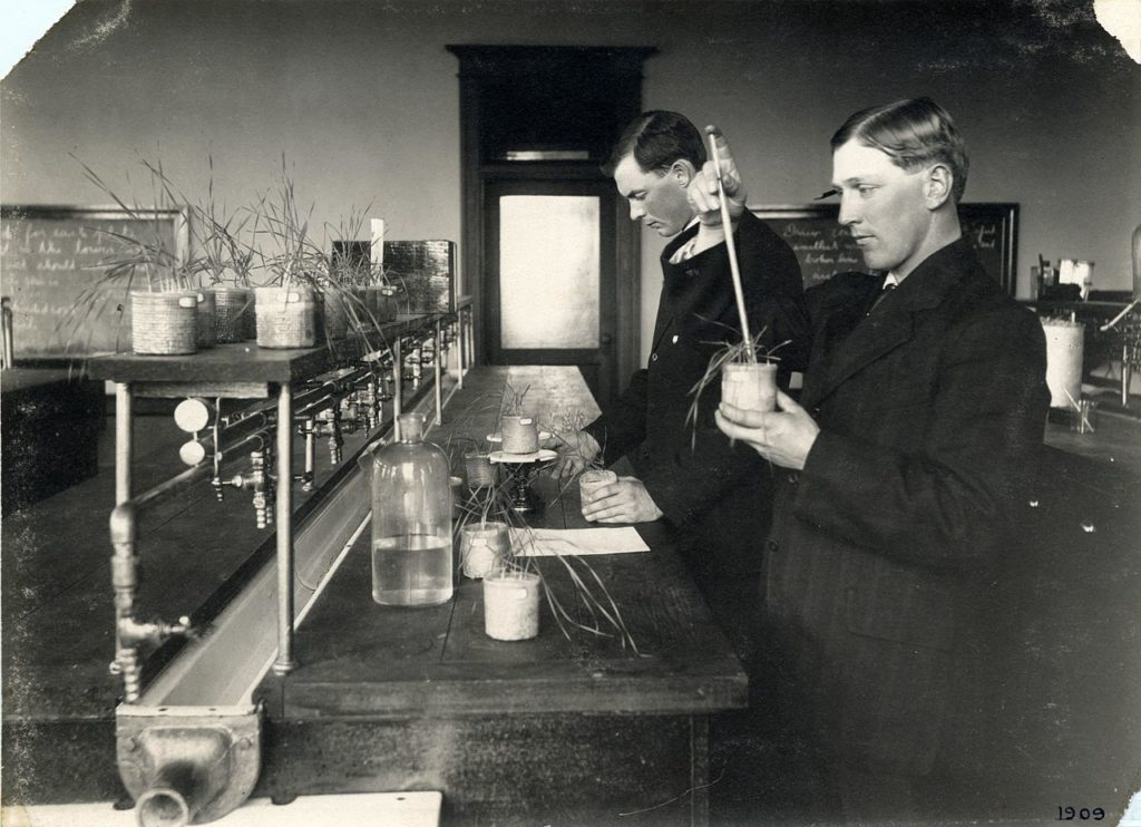 Students testing soil fertility, circa 1816. (Source: By OSU Special Collections & Archives: Commons [No restrictions], via Wikimedia Commons)