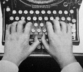 Hands on an Underwood Typewriter keyboard.
