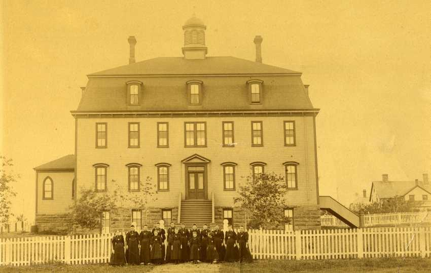 Teachers and students outside Holy Angels Convent circa 1885. (Photo via Beaton Institute Class at Holy Angels Convent circa 1945. (Photo by Abbass Studios via Beaton Institute https://beatoninstitute.com/)