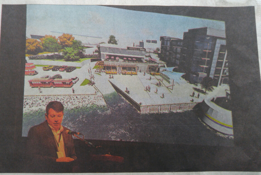 "Ambassatours' Dennis Campbell pictured on the front page of the Cape Breton Post with a ""conceptual video"" of the Sydney waterfront."