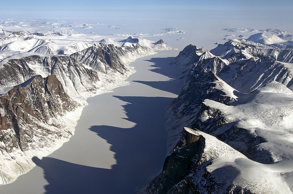 Ice-covered fjord on Baffin Island with Davis Strait in the background.By NASA/Michael Studinger [Public domain], via Wikimedia Commons