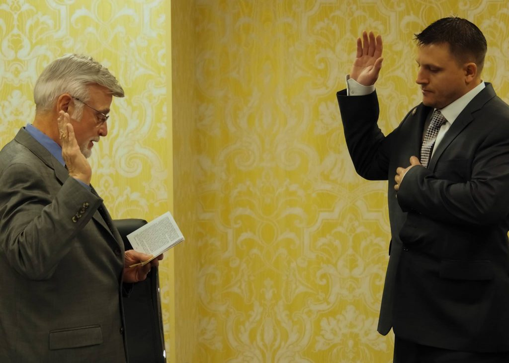 UMWA President Cecil C. Roberts swears in Jody Dukart as the union's auditor/teller for Canada. October 2017. (Photo via Facebook https://www.facebook.com/UMWAunion/)