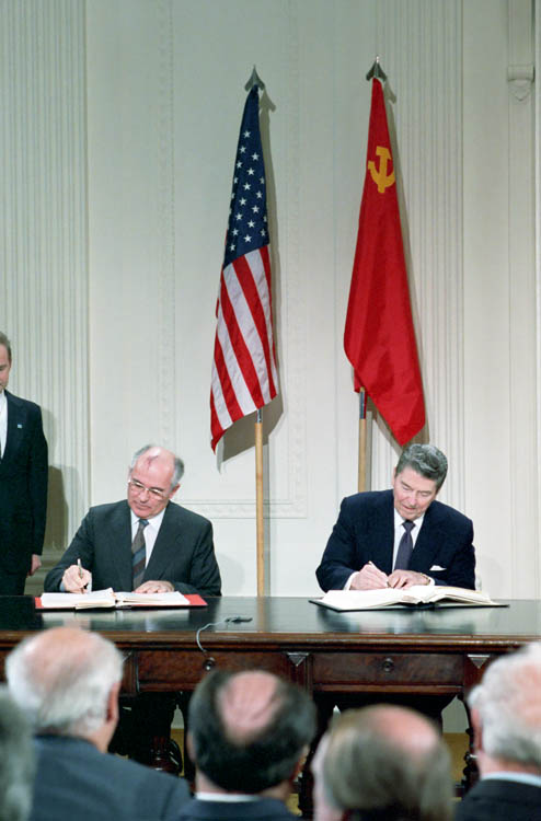 12/8/1987 President Reagan and Soviet General Secretary Gorbachev signing the INF Treaty in the East Room