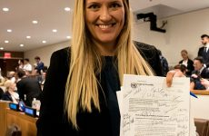 Beatrice Fihn, Executive Director of ICAN, with the signed UN Treaty on the Prohibition of Nuclear Weapons, 7 July 2017. (Photo: Clare Conboy)