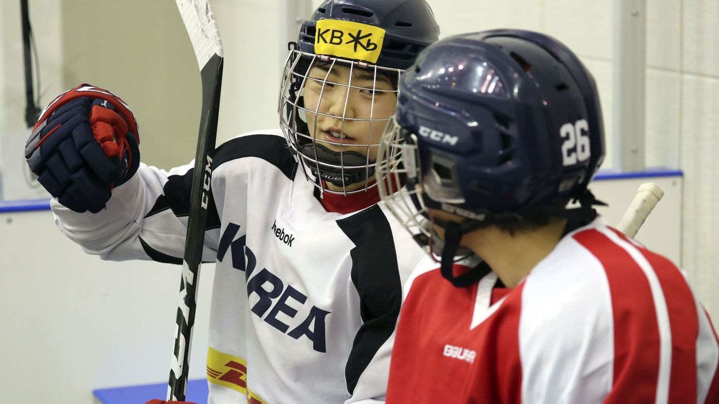 A photo from the Korean Sport and Olympic Committee shows South Korean (white jersey) and North Korean (red jersey) women ice hockey team players talking during a training session in Jincheon, South Korea, on Jan. 28. (Handout/EPA-EFE/REX/Shutterstock)