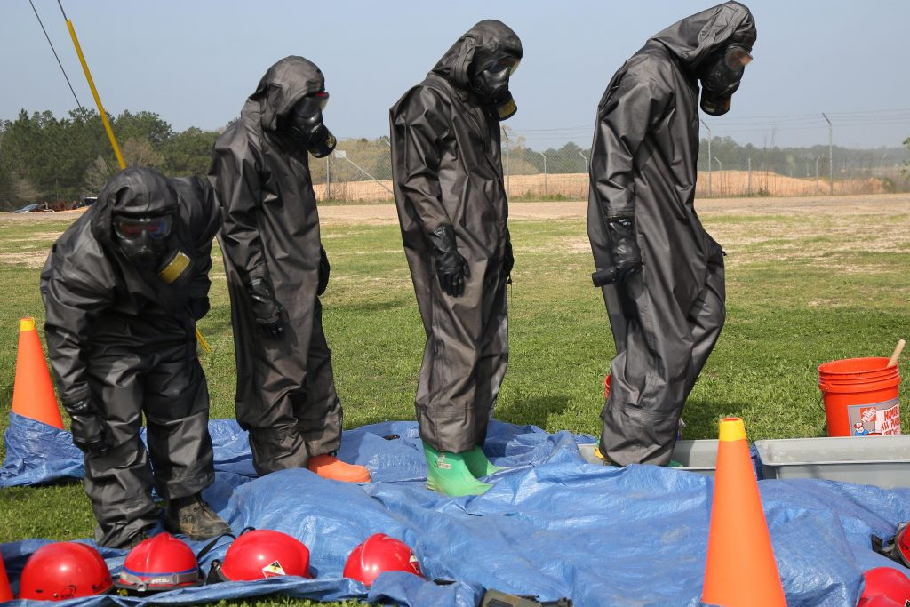 Soldiers perform self-decontamination procedures during a chemical, biological, radiological and nuclear defense training exercise at the Joint Readiness Training Center on Fort Polk, La., March 15, 2016. The soldiers are assigned to the 21st Chemical Company. Army photo by Spc. Ashley Marble