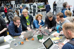 """""""Learn how to code with Arduino and the Garoa Dojo Shield,"""" makerspace Berlin, 2016. (Photo by re: publica from Germany CC BY 2.0 (https://creativecommons.org/licenses/by/2.0)], via Wikimedia Commons"""