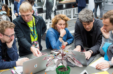 """Learn how to code with Arduino and the Garoa Dojo Shield,"" makerspace Berlin, 2016. (Photo by re: publica from Germany CC BY 2.0 (https://creativecommons.org/licenses/by/2.0)], via Wikimedia Commons"