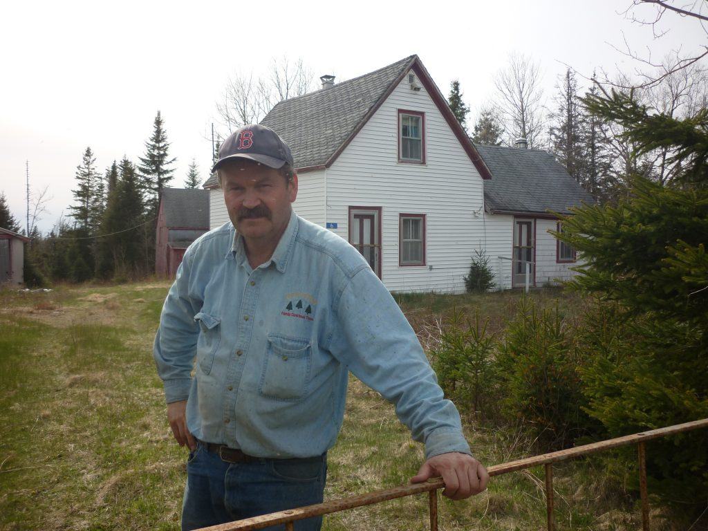 Forest Higgins (Junior) in front of the old Higgins family home in Moose River, which was expropriated and demolished for Atlantic Gold's Touquoy mine. (Photo courtesy the Higgins family)