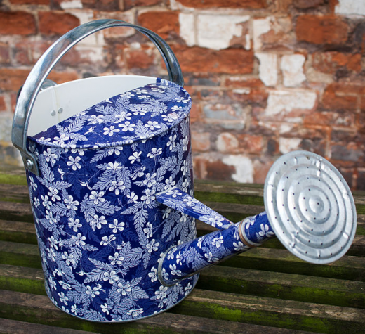 Decorative watering can. (Photo by By Simon Q from United Kingdom (Decorative Watering CanUploaded by tm) [CC BY 2.0  (https://creativecommons.org/licenses/by/2.0)], via Wikimedia Commons, cropped)
