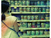 Woman shopping for baby formula, Singapore. (By ProjectManhattan. CC0, from Wikimedia Commons)