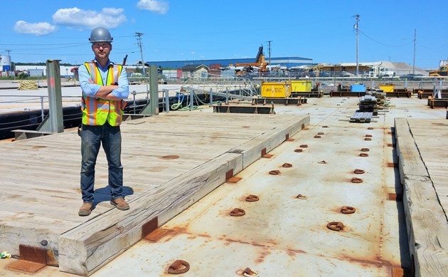 The original caption for this photo read: Mike Moore, regional manager of commercial interests for Heddle Marine Service's East Division in Sydney, stands on the deck of a barge that is being repurposed at the company's wharf in Sydport Industrial Park. The barge was used to service the oil and gas industry off Newfoundland, and will soon be used to service a mining company after the steel and lumber are taken off the deck, to be replaced with another configuration the client has requested. (TOM AYERS / Local Xpress)