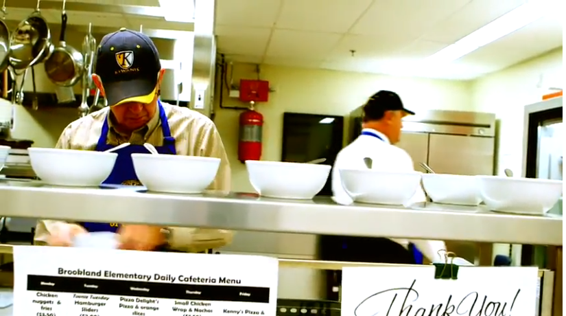 Kinsmen volunteers at the Brookland Elementary School breakfast program. (Source: YouTube)
