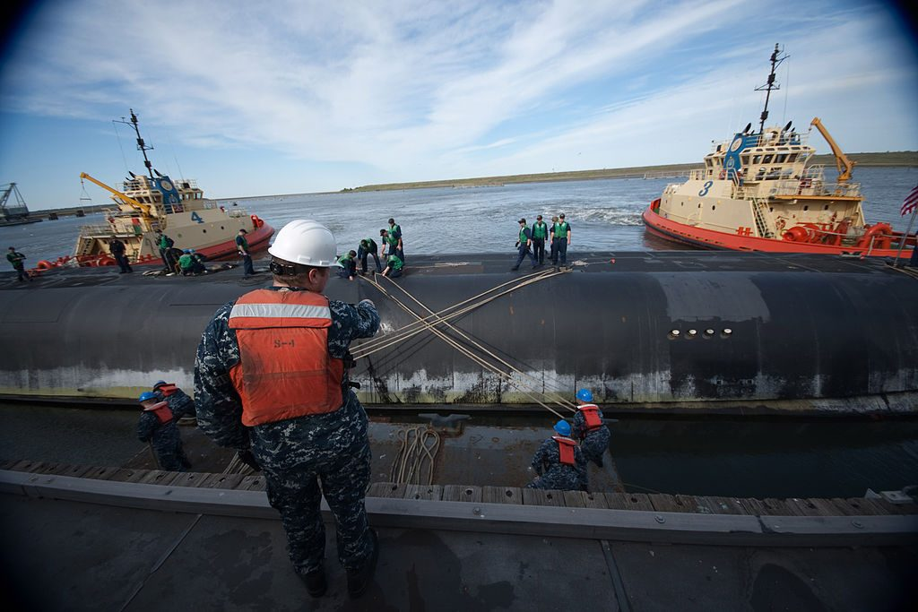 KINGS BAY, Ga. (April 5, 2011) Boatswain's Mate 1st Class Ted Marsh, mooring supervisor for the Trident Refit Facility, directs line handlers mooring the ballistic-missile submarine USS Alaska (SSBN 732) at Naval Submarine Base Kings Bay. Alaska returned to homeport following a three-month patrol at sea. (U.S. Navy photo by Mass Communication Specialist 1st Class James Kimber/Released)
