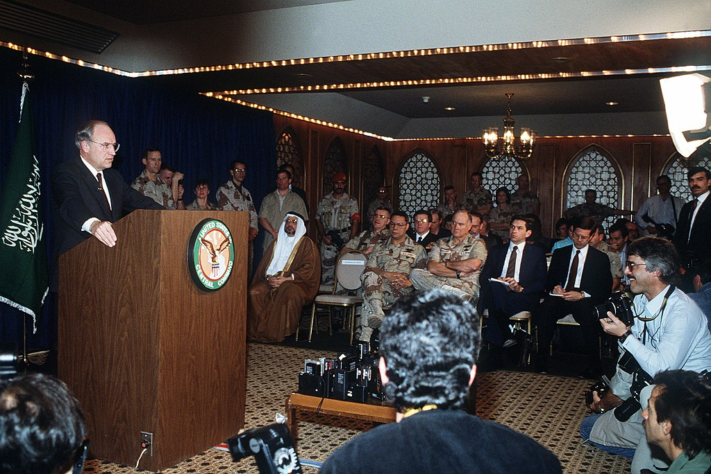 Secretary of Defense Dick Cheney responds to questions from the media while taking part in a press conference held by U.S. and Saudi Arabian officials during Operation Desert Storm. 1 February 1991