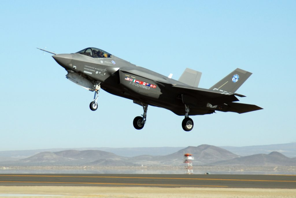 An F-35 Joint Strike Fighter, marked AA-1, lands Oct. 23 at Edwards Air Force Base, Calif. The F-35 Integrated Test Force staff concluded an air-start test. (U.S. Air Force photo/Senior Airman Julius Delos Reyes)