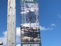 Archibald's Wharf sign, North Sydney, NS. March 2019. (S. Campbell photo)