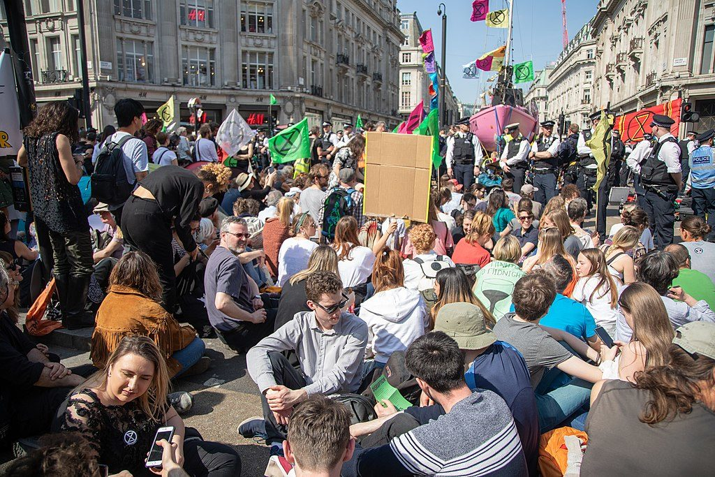 Extinction Rebellion (XR) protests, London, UK, April 2019. (Photo by Jwslubbock [CC BY-SA 4.0 (https://creativecommons.org/licenses/by-sa/4.0 via Wikimedia Commons)