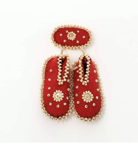 Beaded booties created by Irene Richard to the MMIWG inquiry Gallery of Artistic Expression (https://www.mmiwg-ffada.ca/artists/beaded-booties/)