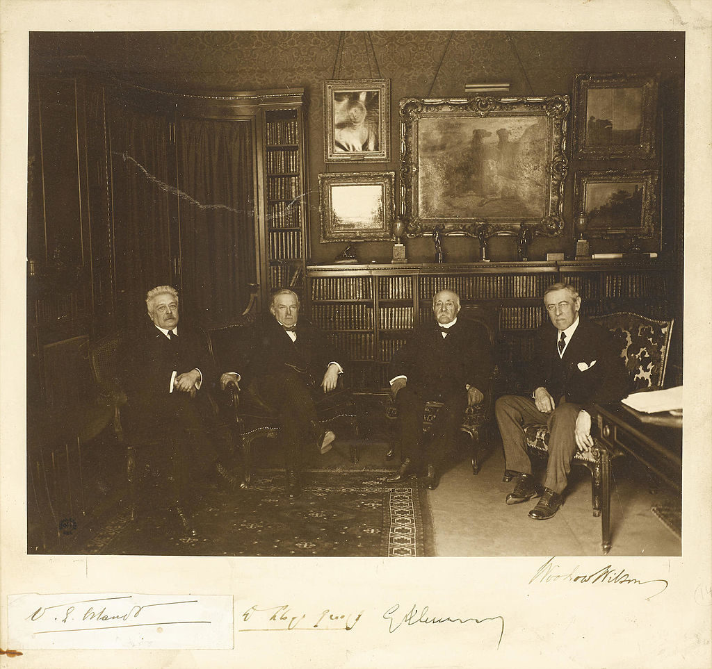 "Photograph Signed by the ""Big Four"" of the Versailles Peace Conference, WOODROW WILSON as President of the United States, GEORGES CLEMENCEAU as Premier of France, DAVID LLOYD GEORGE as Prime Minister of the United Kingdom, and VITTORIO ORLANDO as Prime Minister of Italy. (Public Domain via Wikimedia Commons)"