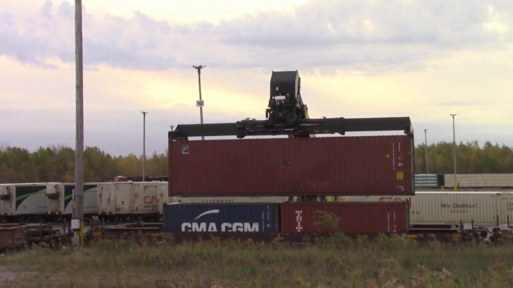 Loading a Container at Moncton Gordon Yard Intermodal Terminal (Oct 18, 2017 Source: YouTube https://www.youtube.com/watch?v=guNKTTMyIIE)