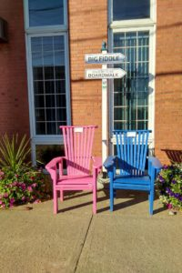 Adirondack chairs, flowers and signage. Charlotte Street, Sydney, NS (Spectator photo)