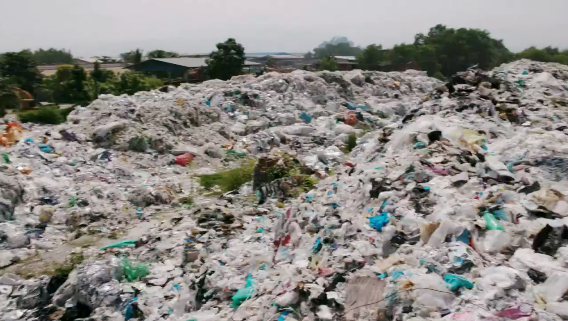 Malaysian plastic dump. Screenshot from CBC Marketplace episode on Canadian recycling. https://www.cbc.ca/marketplace/