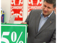 Prime Minister Stephen Harper uses a sign to show a future 1 percent cut to the Goods and Services Tax (GST) at a Giant Tiger department store, on Friday June 30, 2006. The tax cut takes effect on July 1, 2006. JANA CHYTILOVA / OTT