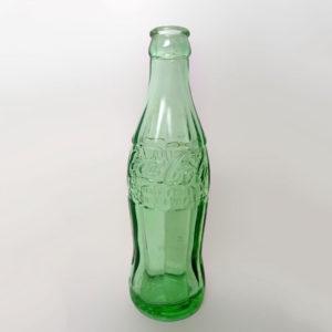 Empty 6.5 oz coke bottle.