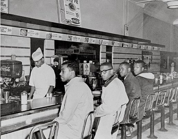Franklin McCain, Ezell Blair Jr, Joseph McNeil and David Richmond, the Greensboro Four, 1 February 1960. (Jack Moebes/Corbis)