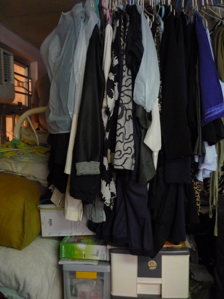 """Closet in one of Hong Kong's subdivided or """"cubicle"""" low-income flats.https://www.scmp.com/news/hong-kong/education-community/article/2022430/theyre-just-us-exhibition-shines-light-hong-kongs (Source: World Green Organization http://thewgo.org/website/eng/)"""