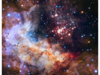 April 23, 2015: NASA and ESA are celebrating the Hubble Space Telescope's silver anniversary of 25 years in space by unveiling some of nature's own fireworks — a giant cluster of about 3,000 stars called Westerlund 2. The cluster resides inside a vibrant stellar breeding ground known as Gum 29, located 20,000 light-years away in the constellation Carina. The comparatively young, 2-million-year-old star cluster contains some of our galaxy's hottest, brightest, and most massive stars. The largest stars are unleashing a torrent of ultraviolet light and hurricane-force winds that etch away the enveloping hydrogen gas cloud. This creates a fantasy celestial landscape of pillars, ridges, and valleys. (NASA, ESA, the Hubble Heritage Team (STScI/AURA), A. Nota (ESA/STScI), and the Westerlund 2 Science Team [Public domain]