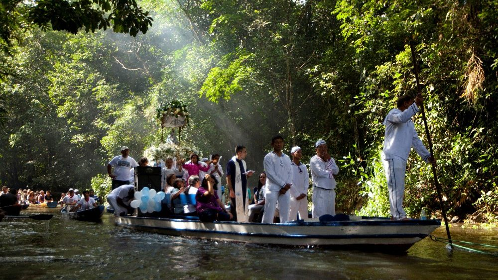 Pilgrims take part in a river procession in the Amazon Jungle.