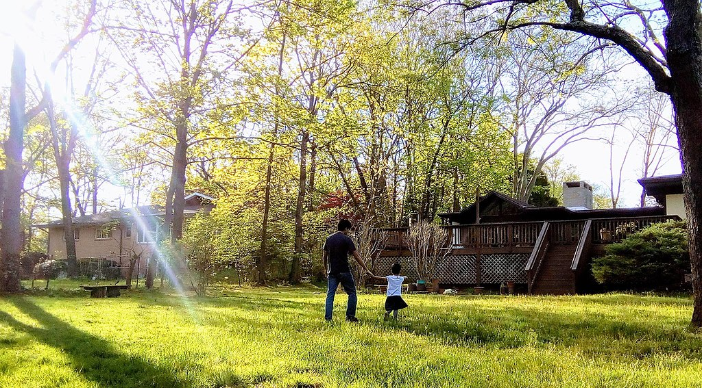 Father and daughter in back yard.