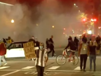 Protestors run from tear gas, Denver. (YouTube screen grab)
