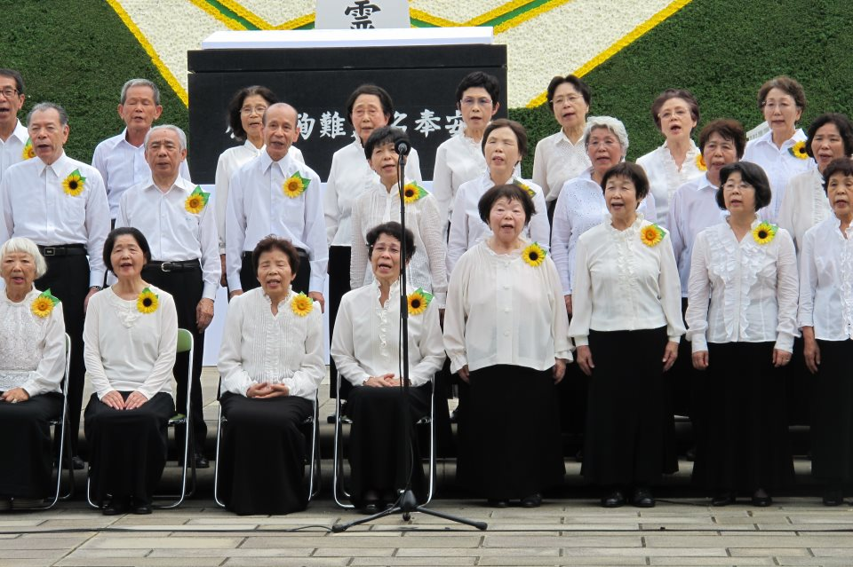 "A choir of Hibakusha (atomic bomb survivors) sing ""Never Again,"" 2012. (Source: The Official CTBTO Photostream / CC BY (https://creativecommons.org/licenses/by/2.0)"