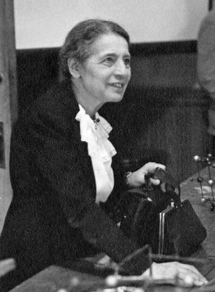 Lise Meitner lecturing at Catholic University in Washington, DC, 1946. (Smithsonian Institution)