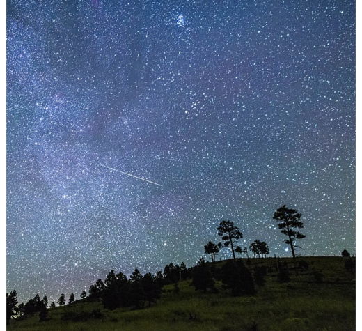 Night sky viewed from the hills surrounding O'Leary Peak. A bright meteor streaks across the center of the scene. Photo taken September 17, 2017 by Deborah Lee Soltesz. Credit U.S. Forest Service Coconino National Forest.