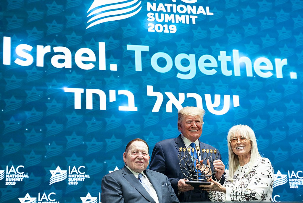 President Donald J. Trump receives a menorah from Miriam and Sheldon Adelson at the Israeli American Council National Summit Saturday, Dec. 7, 2019, in Hollywood, Fla. (Official White House Photo by Joyce N. Boghosian)