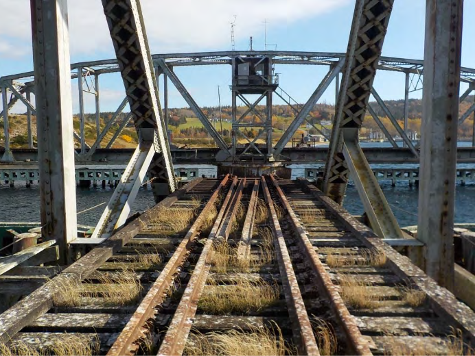 "Rotten and split ties with ""significant vegetation"" on the Grand Narrows swing bridge. (Hatch)"