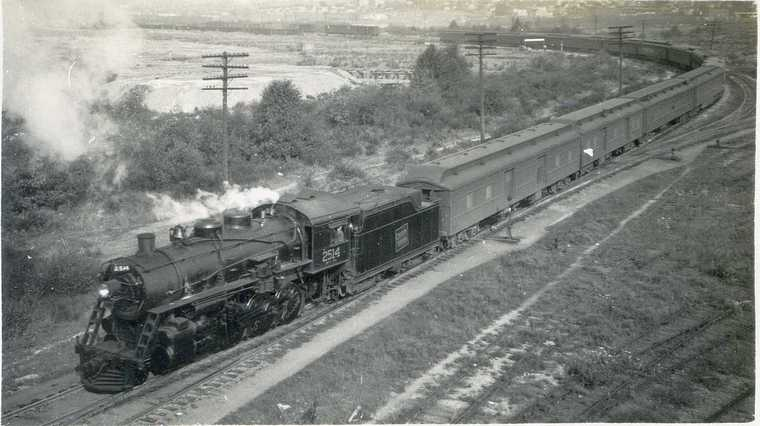 2514 with a long passenger train. Vancouver July 1938 Bud Laws Collection
