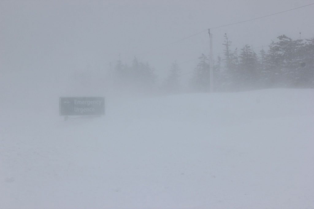 Emergency Sign in snowstorm, North Mountain, Cape Breton